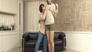 A lengthy tall beauty and a short dude
