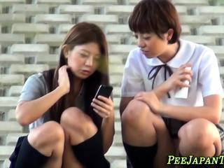 Teen asians urinating