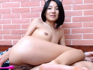 Booty shaking Asian Mikka teases with tiny butthole