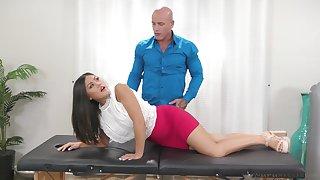 Horny, tattooed man is fucking Kendra Spade better than her boyfriend, in a massage room
